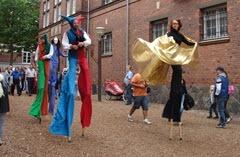 photo of stilt walkers