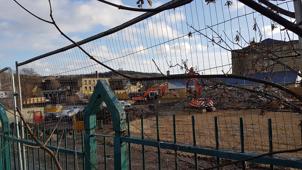 photo of contractors breaking ground for the new college. Taken from Commercial Road, Dewsbury