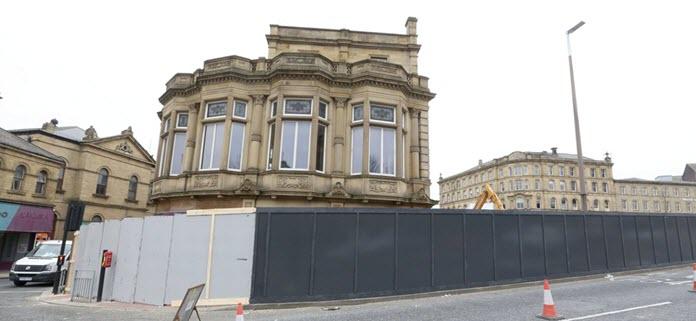 photo of new hoardings around Pioneer House, Dewsbury during regeneration work