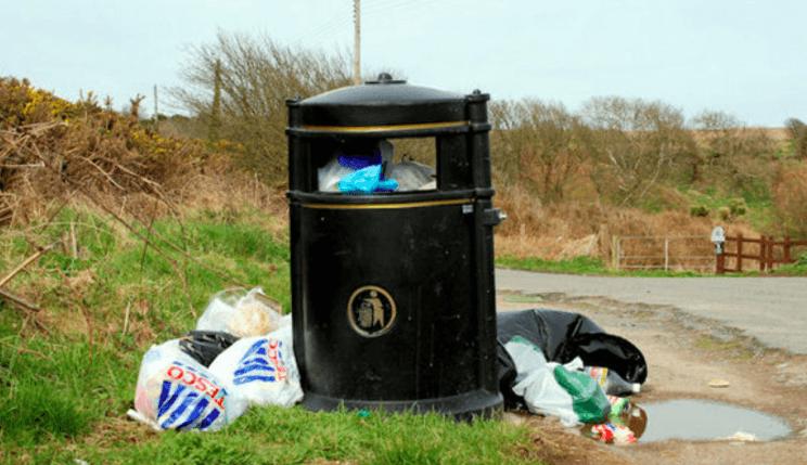 photo of litter bin and rubbish