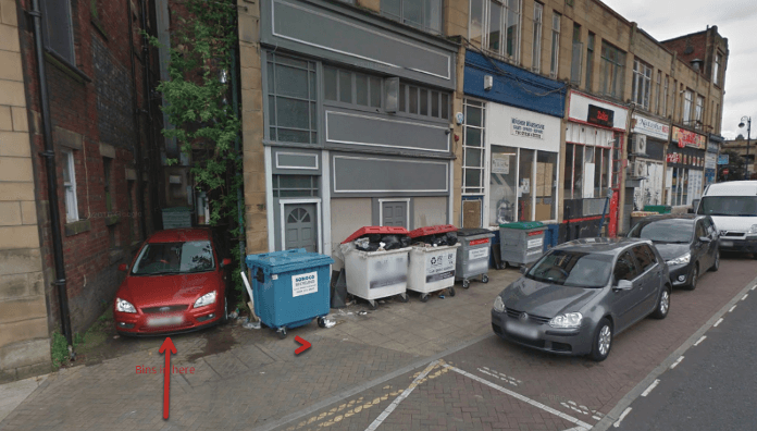 photo of rubbish bins outside Foundry Street shops