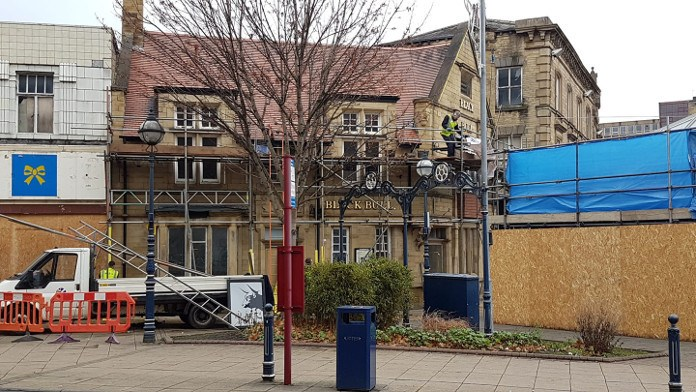 photo of Scaffolding going up around the Black Bull in Dewsbury Market Place